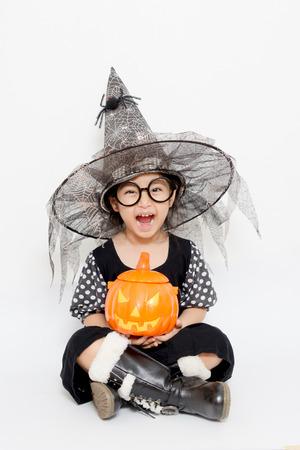 child with pumpkin in halloween